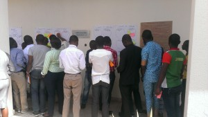 Participants using sticky notes to chose what to learn and what to teach